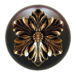 """Inviting Home - Opulent Flower Walnut Wood Knob (bright brass) - Opulent Flower Walnut Wood Knob with hand-cast bright brass insert; 1-1/2"""" diameter Product Specification: Made in the USA. Fine-art foundry hand-pours and hand finished hardware knobs and pulls using Old World methods. Lifetime guaranteed against flaws in craftsmanship. Exceptional clarity of details and depth of relief. All knobs and pulls are hand cast from solid fine pewter or solid bronze. The term antique refers to special methods of treating metal so there is contrast between relief and recessed areas. Knobs and Pulls are lacquered to protect the finish. Alternate finishes are available. Detailed Description: The Opulent Scroll pulls add an amazing focus to any drawers or cabinets - it will make them look regal and majestic. The absolute perfect place for these pulls to be used is in the dining room on your china closet. They are great pulls to use if you are trying to punch up an antique piece of furniture or cabinet. You should consider using the Opulent Scroll pulls in combination with the Opulent Flower knobs or wood knobs with flower."""