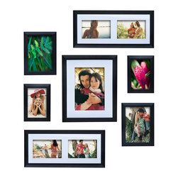 Philip Whitney - 7 Piece Frame Set - Achieve a simple, clean look in your home using this Frame Set. Featuring plain black wood, this frame set includes seven frames with options for side-by-side photos and horizontal and vertical arrangements. Display the frames individually or layer them for a dynamic, gallery-style effect.