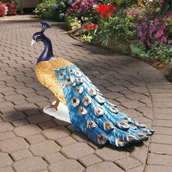 "Design Toscano - The Regal Peacock Garden Statue - Now European elegance can be proudly displayed in your garden with this classic Regal Peacock Statue. Almost a full yard of gold and blue peacock plumage shines across an expansive panorama in this classic peacock statue. The artisans have hand-painted each feather of this finely crafted, quality designer statue in the peacock's royal palette. Features: -Hand painted.-Customers are encouraged to bring in items during severe weather conditions or to spray items periodically with clear coat protection to extend the life of the finish..-Distressed: No.-Material: Resin.-Number of Items Included: 1.-Fade Resistant: Yes.-UV Resistant: Yes.-Mildew Resistant: No.-Powered: No.-Lighted: No.-Mounting Required: No.-Powder Coated Finish: No.-Gloss Finish: No.-Product Care: Store indoors during freezing winter weather..Dimensions: -Overall Height - Top to Bottom: 21"".-Overall Width - Side to Side: 34"".-Overall Depth - Front to Back: 12.5"".-Overall Product Weight: 14 lbs.Assembly: -Assembly Required: No.-Additional Parts Required: No."