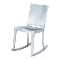 Emeco - Hudson Rocking Chair - If you want a simple rocker that doesn't overpower a room, consider this great Emeco option. The company began around WWII to create chairs for the military, and have continued a tradition of blending durability with beauty. The solid back add a smooth touch to a normal rocker back.