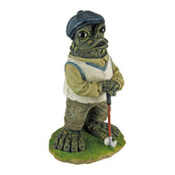 Toad Hollow Stading Golfer Frog Statue Golf Green - The Toads Of Toad Hollow are a collection of statues that add whimsy and imagination to your home. This standing golfer frog is secretly hoping his drive doesn`t clear the pond! He wears a beige sweatervest, tan shirt and pants, and a dark blue newsboy cap, and holds a long iron in his hands. His eyes are made of glass, and seem to follow you around the room.  Made of cold cast resin, the frog measures 13 inches tall, 8 inches wide and 6 inches deep. He`s hand-painted, and shows great detail. He makes a wonderful gift for any golf fanatic.