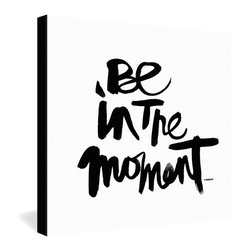 DENY Designs - Kal Barteski Be In The Moment Gallery Wrapped Canvas - When your busy modern lifestyle becomes too full of distractions, this simple yet eye-catching piece will stop you in your tracks with a gracefully hand-scripted reminder to be aware of the present moment. The ink brush writing style is reminiscent of Asian calligraphy, infusing a hint of Zen silence into the message. The frameless canvas is bordered in black for a little extra definition.