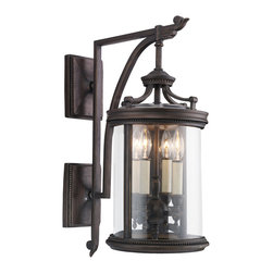 "Fine Art Lamps - Louvre Outdoor Wall Mount, 538581ST - Inspired by the hand-crafted lanterns that have lit the Paris Louvre for centuries, this outdoor sconce lantern has a traditional European, novel-esque charm. The antique Craftsman style features elegantly simple lines with subtle beading details and an interior candelabra base with four antiqued ""candles."" A clear, handblown glass shade and rustic bronze metal finish complete the look."