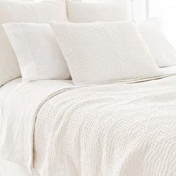 Pine Cone Hill - PCH Seychelles Dove White Quilt - The Seychelles quilt makes a rich accompaniment to a range of modern styles. Dove white tone-on-tone topstitching offers this cozy PCH accessory subtle texture. Available in twin, full/queen and king; 100% cotton; Designed by Pine Cone Hill, an Annie Selke company; Machine wash
