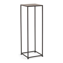 Tag Furniture Group - Urban Pedestal in Coco Finish - 16 mm. thick steel top. 0.5 in. square hot-rolled steel bar. Sleek design is well suited for smaller spaces. No assembly required. Made from solid steel rods and steel plate tops. Tables feature a beautiful and durable powder coat finish. 11.75 in. L x 11.75 in. W x 36 in. H (17 lbs.)Tag's vision is to bring well-designed, stylish and affordable products into the home of every consumer.