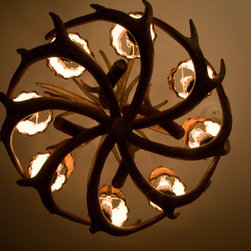 """Streeterville Townhome Chicago Condo - """"Antler"""" chandelier for a lower level bar area which emphasizes the owners love of hunting and fishing.  Velum shades w/ leather whip stitching to finish the rustic look."""