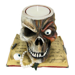 GHOUL`S NIGHT Rotting Skull On Book Candle Holder - This wickedly awesome decaying human skull pillar candle holder makes a perfect centerpiece for Halloween decorations, or for people that like gothic, creepy decor. The skull sits atop an open book, with an eyeball sitting on one of the pages. Made of cold cast resin, it stands 6 1/2 inches tall (without candles), is 7 1/2 inches deep, and 8 1/2 inches wide. It holds candles up to 3 1/4 inches wide. It makes a great gift for any skull lover.