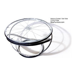 Modulus Side Table - I think the things Gregg can do with recycled bike parts is amazing. This table has a sleek contemporary look but can't help but be a little playful on second glance with the spokes of the wheel showing through the glass table. It's a lot of fun.