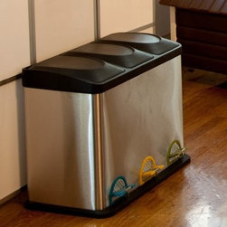 Organize It All Step-On 11.89 Gallon Stainless Steel Recycling Bin - Make recycling easy without taking up a lot of space with the Organize It All Step-On 11.89-Gallon Stainless Steel Recycling Bin. Designed to make recycling easy, this bin features three separate compartments for recyclables so you can decide on the best recycling program for your family. The hands free feature makes recycling a breeze, while the stainless steel construction not only looks great, but is strong and durable as well. You can use these bins to recycle bottles, cans, glass, plastic, or paper, and the pedals are color-coordinated making it easy to remember which item goes where. This recycling bin holds up to 11.89 gallons of recyclables and measure 24L x 13.5W x 19H inches.About Organize It AllWith masterful designs using top-quality materials, Organize It All is dedicated to providing convenient and stylish storage solutions for every room in your home, believing that a well-organized environment is more enjoyable. Offering over 500 products for everyday use, the company maintains a warehouses in Saddle Brook, New Jersey, and Costa Mesa, California, for quick delivery to your home.
