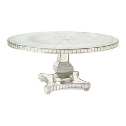 Kathy Kuo Home - Millie Hollywood Regency Antique Mirror Silver Round Dining Table - In a recent interview, one of the brightest names in fine jewelry and interiors (hint: she's rock & roll royalty) revealed that her favorite interior 'signature move' is to put disco balls in dining rooms.  This gorgeous round mirrored table delivers the same mood, but in a more grown-up, regal manner replete with distressed silver finishes,  bun feet and a geometric web pattern radiating from the center.