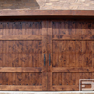 Dynamic Garage Door - Mediterranean Revival 07 | Architectural Wood Garage Doors Made in California! - A fantastic Mediterranean Custom Garage Door, this Alder Garage Door is perfectly accentuated with beefy hand-forged hinge straps and iron forged handles. Naturally rustic, Alder comes in a knotty complexion that gives it distinctive character. Paired with old-world decorative iron features as seen on this customized Mediterranean garage door make this custom garage door a naturally feature that flows well with the rest of the entry doors on this Mediterranean home.