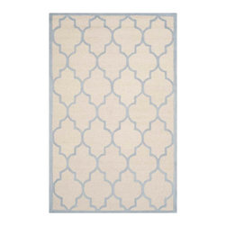 Safavieh - Annette Hand Tufted Rug, Ivory / Light Blue 4' X 6' - Construction Method: Hand Tufted. Country of Origin: India. Care Instructions: Vacuum Regularly To Prevent Dust And Crumbs From Settling Into The Roots Of The Fibers. Avoid Direct And Continuous Exposure To Sunlight. Use Rug Protectors Under The Legs Of Heavy Furniture To Avoid Flattening Piles. Do Not Pull Loose Ends; Clip Them With Scissors To Remove. Turn Carpet Occasionally To Equalize Wear. Remove Spills Immediately. Bring classic style to your bedroom, living room, or home office with a richly-dimensional Safavieh Cambridge Rug. Artfully hand-tufted, these plush wool area rugs are crafted with plush and loop textures to highlight timeless motifs updated for today's homes in fashion colors.