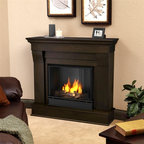 Real Flame - Chateau Ventless Gel Fireplace in Dark Walnut - Includes: Mantel, firebox, hand painted cast concrete log, and screen kit. Solid wood and veneered MDF construction. Uses Only Real Flame 13oz Gel Fuel Cans, not included. Uses clean burning Real Flame Gel fuel emitting up to 9,000 BTUs of heat per hour lasting up to 3 hours. Assembly Required. 40.9 in. W x 11.8 in. D x 37.6 in. H (67.6 lbs.)The Chateau Fireplace features the clean lines and classic stylingfamiliar to stone mantels, realized in wood. The hand-painted log set and bright crackling flame add to the realistic look of this Real Flame Gel Fuel Fireplace. Uses 3 - 13oz. cans of Real Flame Gel Fuel.
