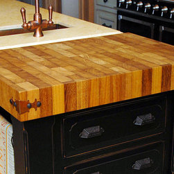 Iroko Butcherblock Kitchen Countertop by Grothouse - 4 inch Iroko Butcherblock Countertop in brown and blond colors with 1/8 inch Roundover edge profile and a Food Grade Oil finish. Photography courtesy of Grothouse Lumber Co.