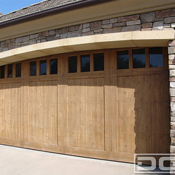 """Dynamic Garage Door - California Dream 17   Carriage House Style Garage Door in a Traditional Design - Select Tight Knot Cedar Custom Garage Door in a natural state, no stain or pigmentation was added to this garage door. This is natural wood at its simplest with only a satin clear coat to protect the wood from the natural elements you can surely enjoy the bare color of select tight knot cedar. The tongue and groove design with square windows at the top are typical of carriage house garage door styles but leaving the wood """"in the raw"""" differentiates this two car custom wood garage door from the rest."""