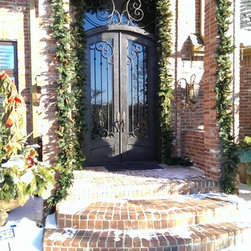 """Holiday Doors - 71"""" x 120""""  Arch top door with 71"""" x 41.25"""" transom. Hand Rubbed Bronze with Flemish glass"""