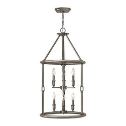 Hinkley Lighting - Hinkley Dakota Polished Antique Nickel Six-Light Mini-Chandelier - The Dakota collection rounds up the best in Western style with a rustic chic design. Cast metal faux leather straps and buckle combine with clear seedy hurricane shades perched on cast cups for luxe lodge charm.Under four generations of family leadership Hinkley Lighting has transformed from a small outdoor lantern company to a global brand intent on bringing you the best in style quality and value. LIFE AGLOW: That's their mantra and they take it seriously. By welcoming their products into your home they become part of your family's everyday life illuminating small moments and big occasions. They understand your home is so much more than a physical place. It's an emotional space designed by you so they are committed to keeping your 'Life Aglow' with stylish state-of-the-art lighting. Their products are the ultimate combination of style and substance. They are constantly developing new technologies to make their fixtures even more energy efficient. Hinkley recently upgraded their LED to cutting-edge high lumen output integrated solutions and they give you hundreds of energy-efficient styles to choose from. Even their Cleveland-based world headquarters employs high energy saving standards with low VOC materials and a variety of eco-smart applications into the design to make an earth-friendly work environment for their Hinkley family. Hand crafted fixtures luxe finishes artistic details and quality materials go into the design of every product they make. They embrace the philosophy that you can merge together the lighting furniture art and accessories you love into a beautiful environment that defines your own personal style.