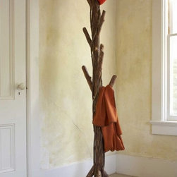Twisted Vine Coat Rack - I love rustic elements combined with modern and clean lines. I also love the combination of the thick branches and thin vines on this coat rack.