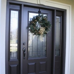 Black Front Door with Glass Work & Unique White Doorway Trim - A black ...