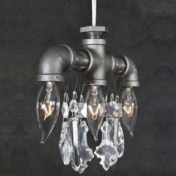 """Michael McHale Designs - Tribeca 3-Light Pendant by Michael McHale Designs - A material mash-up of utilitarian and swank aesthetics, the Michael McHale Designs Tribeca 3-Light Pendant ingeniously marries the humble steel pipe with the luxuriousness of high-quality, fully-leaded European crystal. And then makes it available at a rather humble price. The repurposed steel conduits include a trio of flame-tipped candelabra bulbs, and a choice of suspension lengths. An inventive juxtaposition of the utilitarian and the exquisite, Michael McHale Designs displays an aesthetic sensibility that undercuts tidy categorization. Repurposed steel pipes are ruggedly raw; high-quality, fully-leaded crystals confer luxuriousness; the regular use of flame-tipped candelabra bulbs play off a traditional archetype long associated with elaborate chandeliers. The disparate material mediums stylistically balance the high and the low, successfully coalescing into a unique amalgamation that McHale understandably references as """"industrial chic."""""""