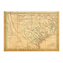 Folded Map: Texas - Framed - The appeal of vintage maps is universal, catching the attention of the cartography enthusiast and the imaginative amateur alike. This example, an antique map of Texas which features a grid of worn and feathered lines where the original would have been creased for transport, is a striking four feet wide. Its shades of parchment with touches of indigo and umber are enclosed in a dark wood frame.