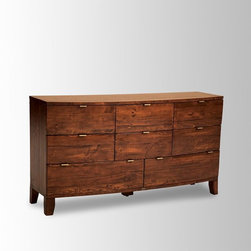 Rounded Wood 8-Drawer Dresser - This is a really beautiful use of natural wood, and I love the unexpected layout of drawers and interesting pulls.