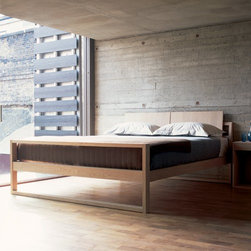 de La Espada - de La Espada | 640 Parallel Bed - Made in Portugal by De La Espada. Perfect for the minimalist designer or a room with an established décor, the 640 Parallel Bed features clean lines and unlimited styling possibilities. The rich grain of solid hardwood adds warmth to this angular bed. A graceful form is achieved through a medley of rectangles and the looped legs allow the bed to hover above the floor providing ample under-bed storage. Available for a Queen, King, and California King mattress in a variety of finishes and solid woods, this modern bed will be the ideal addition of your bedroom. Solid planks are connected with mortise and tenon joints to provide a sturdy and durable bed that will withstand the test of time. Produced with energy efficient techniques from sustainably sourced wood only adds to the appeal of this modern bed. Mattress not included, box spring not required.