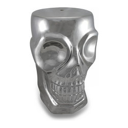 Zeckos - Metallic Silver Finish Ceramic Human Skull Stool / Plant Stand - This amazingly creepy ceramic stool is shaped like a human skull, and is finished in a polished metallic silver. It measures 18 1/2 inches tall, 11 inches wide and 10 inches deep. The top is slightly rounded for a more comfortable feel, but is still flat enough that it can double as a plant stand or pedestal for a statue. It makes a great gift for anyone with a taste for the macabre.