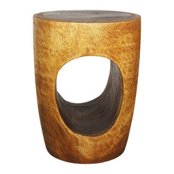 Kammika - Big Eye Wood End Table 15 D x 12 Base x 20 inch H Monkey Pod in Livos Walnut Oil - With our Sustainable Monkey Pod Wood Big Eye 15 inch Diameter x 20 inch height and 12 inches at the base in Eco Friendly Natural, food-safe Livos Walnut Oil Finish End Table, you can look into the eye of the piece and see the history of its growth. Each is hand carved and has a unique story to tell. Finished in translucent Livos Walnut Oil allows the wood color and grain shows through. This elegant sturdy piece can serve as an end table, display stand, or a stool. They are designed for use stand alone or in groups, and are appealing to the viewer from any angle. No two are alike. The wood is from sustainable sources, and eco friendly Livos finishes create functional works of eco friendly art. Craftspeople from the Chiang Mai area in Northern Thailand create these pieces with the simplest of tools. Each Sustainable Monkey Pod Wood (Acacia, Koa, Rain Tree grown for wood carving) piece is kiln dried, carved, sanded, and rubbed in Livos Walnut tone oil polished to a water resistant and food safe matte finish. The color ranges from medium to dark Walnut brown tones that will darken as the wood ages; the wood grain detail is highlighted. There is no oily feel, and cannot bleed into carpets. Made from the thick branches of the quick-growing Acacia tree - where each branch is cut and carved to order (allowing the tree to continue growing), all products are dried in solar or propane kilns. No chemicals are used in the process, ever. This piece is packaged with cartons from recycled cardboard with no plastic or other fillers. As this is a natural product, the color and grain of your piece of Nature will be unique, and may include small checks or cracks that occur when the wood is dried. Sizes are approximate. Products could have visible marks from tools used, patches from small repairs, knot holes, natural inclusions or holes. There may be various separations or cracks on your piece when it arrives. There may be some slight variation in size, color, texture, and finish color. Only listed product included.