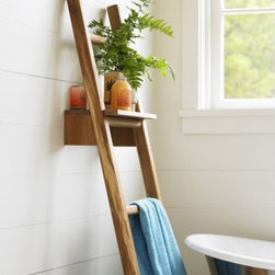 "Viva Terra - Teak Ladder with Shelf - Our teak ladder is the ultimate eco-choice made from leftover cuttings of sustainable teak at a furniture factory. The sturdy rungs keep towels neatly organized or become a trellis for vines. Its removable shelf serves as a handy platform for garden ornaments. 18""W x 64""H"