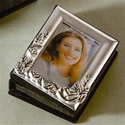 Godinger Silver - Mini Rose Album - The cover of this silver-plated mini photo album doubles as a picture frame. Insert a favorite photo for view on the cover and additional photos inside. Adorn its rose style designs and classy touch for it will surely impress you and your guests. Let the memories of your youth or wedding linger forever! Dimensions: 3 x 1 x 4 inches.