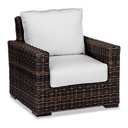 Thos. Baker - Wicker Outdoor Club Chair | Hampton Java Collection - Our most popular over-sized wicker collection is now available in a rich java color weave. Premium, dyed-through resin wicker with an extra large diameter profile and a rich variegated rustic finish. Powder-coated aluminum sub-frame and brushed aluminum feet.Plush Sunbrella cushion sets included where applicable. Choose quick ship in khaki with cocoa piping, stone green or choose from our made-to-order fabric options.Made-to-order cushion sales are final and ship in 2-3 weeks.