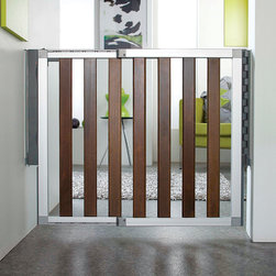 """Munchkin - Loft Wood Safety Gate - Features: -Loft. -Made form dark wood. -Indexed Sizing System (ISS) adjusts for a perfect vertical fit when walls aren't level. -Integrated Tuning System (ITS) allows for quick and easy width adjustments with pre-set index positions. -Quick-release wall mount allows the gate to be removed and replaced quickly for high-traffic times or entertaining. -Use every place in the home-top of stairs, bottom of stairs, between rooms. -Double-locking system on the integrated handle is easy for adults to use, but difficult for a child. -Gate locks shut with just a simple push. -Extra-wide walk through allows for easy in and out access. -Door swings open in both directions. -Designed for children 6-24 months. Dimensions: -30.5"""" H x 26.5-29.5"""" W, 14.12 lbs."""