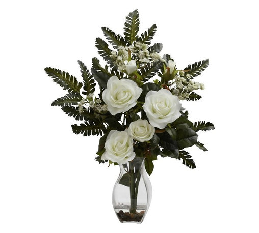 Rose and Christmas Arrangement - Elegance personified. That's exactly what this incredible silk reproduction brings to mind. Here we have the stately rose, with several full blooms front and center, surrounded by delicate leaves, fronds, and blooms of soft white colored floral. This elegance is proudly displayed in a beautiful vase, complete with faux water and river rock. Makes an ideal gift. Height= 21 In. x Width= 16 In. x Depth= 9 In.