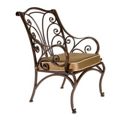 O.W. Lee Ashbury Aluminum Dining Chair - Elegant enough to host a queen and stylish enough to entertain a hatter, the O.W. Lee Ashbury Dining Chair has a wonderfully ornate beauty that suits any company for any occasion. The beautiful scrollwork adds to your outdoor decor a classic appeal that also possesses a fashion-forward individuality. This sensually curving metalwork is hand forged and hammered, bringing a uniquely masterful craftsmanship to these chairs. More than just visually pleasing, however, these chairs are equally designed for comfort. The strong, slightly curved back, the cleverly proportioned arms, and the top-of-the-line foam and fiber filled seat cushion, all make these chairs comfortable seats that encourage diners to sit back and enjoy the leisurely meal that you lovingly prepared.Materials and construction: Only the highest quality materials are used in the production of O.W. Lee Company's furniture. Carbon steel, galvanized steel, and 6061 alloy aluminum is meticulously chosen for superior strength as well as rust and corrosion resistance. All materials are individually measured and precision cut to ensure a smooth, and accurate fit. Steel and aluminum pieces are bent into perfect shapes, then hand-forged with a hammer and anvil, a process unchanged since blacksmiths in the middle ages. For the optimum strength of each piece, a full-circumference weld is applied wherever metal components intersect. This type of weld works to eliminate the possibility of moisture making its way into tube interiors or in a crevasse. The full-circumference weld guards against rust and corrosion. Finally, all welds are ground and sanded to create a seamless transition from one component to another. Each frame is blasted with tiny steel particles to remove dirt and oil from the manufacturing process, which is then followed by a 5-step wash and chemical treatment, resulting in the best possible surface for the final finish. A hand-applied zinc-rich epoxy primer is used to create a protective undercoat against oxidation. This prohibits rust from spreading and helps protect the final finish. Finally, a durable polyurethane top coating is hand-applied, and oven-cured to ensure a long lasting finish. About O.W. Lee Company An American family tradition, O.W. Lee Company has been dedicated to the design and production of fine, handcrafted casual furniture for over 60 years. From their manufacturing facility in Ontario, California, the O.W. Lee artisans combine centuries-old techniques with state-of-the-art equipment to produce beautiful casual furniture. What started in 1947 as a wrought-iron gate manufacturer for the luxurious estates of Southern California has evolved, three generations later, into a well-known and reputable manufacturer in the ever-growing casual furniture industry.