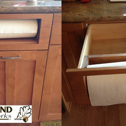 Custom Cabinet Components - A custom paper towel dispenser which pulls out and holds storage for more paper towels. Featured here with a split prairie style door, solid maple dovetail drawer box, full extension soft close drawer guides, and full overlay doors and drawers.