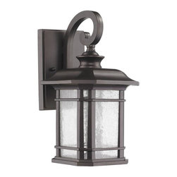 None - Transitional Weatherproof 1-light Bronze Outdoor Wall Light Fixture - This Transitional one-light outdoor wall light fixture features clear seedy glass and will complement your outdoor decor. This wall-mounted outdoor light fixture is weatherproof and corrosion resistant.