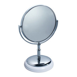 York Vanity Mirror - Stylish and functional, the York Vanity Mirror will makes a great addition to any bathroom counter top or vanity. The York Vanity Mirror features steel construction with an elegant chrome finish and white ceramic accents. The York Mirror features double sided construction with a regular mirror on one side and a powerful 5x magnification mirror on the other. The weighted base provides stability and features a plastic bottom to protect your counter top.