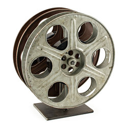 Bambeco Vintage Film Reel Wine Rack - Roll camera Classic Hollywood comes to life in a scene stealing wine rackrepurposed midcentury film reels make the perfect modern wine rack; classic film nostalgia for celluloid and sauvignon blanc lovers alike. For added delighteach reel is wound with a vintage MGM movie ... the name of the actual film identified on its base. Authentic, unique, absolutely a star.   Dimensions: 16H X 14W