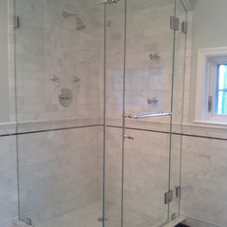 Fully Frameless Glass Shower Enclosure with angled ceiling - This frameless shower enclosure features the inclusion of a through the glass robe hook.  Glass panel has also been cut to follow ceiling profile.