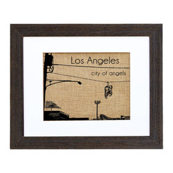Fiber and Water - Los Angeles Art - A simple yet classic image of retro-cool sneakers hanging from the city power lines instantly captures the spirit of Los Angeles. This eclectic print is hand-pressed onto natural burlap, giving it a unique texture and a neutral, versatile color. It comes ready to hang in a contemporary white matte and distressed black wood frame.