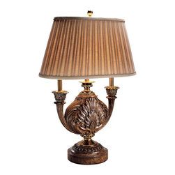 "Maitland-Smith - Maitland-Smith Paliverde Acanthus Table Lamp - From Maitland-Smith this beautiful urn-shaped table lamp is handcrafted of carved wood with brass deco accents and is embellished by an acanthus leaf motif. A pleated silk shade tops the piece. Paliverde finish. Carved wood and brass construction. Pleated silk shade. Takes one 100 watt three-way bulb (not included). 34"" high. Shade is 16 1/2"" by 8 1/2"" at the top 23"" by 10 1/2"" at the bottom and 13"" on the slant. Base to bottom of shade is 18"".  Paliverde finish.   Carved wood and brass construction.   Pleated silk shade.   Takes one 100 watt three-way bulb (not included).   34"" high.   Shade is 16 1/2"" by 8 1/2"" at the top 23"" by 10 1/2"" at the bottom 13"" on the slant.   Base to bottom of shade is 18""."