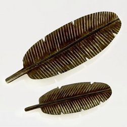 Metal Banana Leaf Trays - These metal banana leaf trays are high on my wish list for summer entertaining wares. Hello, tropic chic.