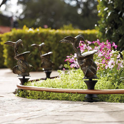 "Frontgate - Hummingbird Hose Guide - Rotating stems guide any standard garden hose smoothly along its path. Unique designs are rustproof cast aluminum. 6-1/2"" stakes anchor the guides securely in the ground. Provides added insurance that a hose won't flatten tender plants. Finials even add a bit of traditional formality to a garden path or bedding plants. Protect your flower-filled borders with Decorative Hose Guides. Stake several of these decorative finials along the landscaping, and a heavy hose will smoothly glide wherever needed, without trampling your green thumb efforts. .  . .  . ."