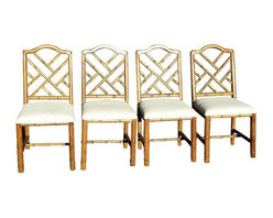 Pre-owned Vintage Chinese Chippendale Chairs - Set of 4 - Four oak colored Chinese chippendale chairs that still feature the original cream textured fabric. We love the gold faux bamboo frames, and think they'd look even more stunning covered in a rich velvet upholstery.     Measurements:  Height - 38 inches  Depth - 19 inches  Width - 16 inches  Seat Height - 19 inches