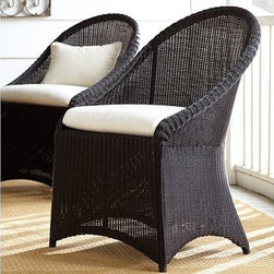 """Palmetto All-Weather Wicker Dining Chair, Set of 4, Black - Crafted of a rugged synthetic that captures the beauty of wicker, our Palmetto dining chair can be left outdoors year round. Click to read an article on {{link path='pages/popups/palmetto-care_popup.html' class='popup' width='640' height='700'}}recommended care{{/link}}. 24"""" wide x 25"""" deep x 35"""" high Woven from slender honey strands that are variegated to replicate wicker's rich texture. Synthetic fibers are superbly weather resistant. Styled with a full apron and arched back. Chairs each include a quick-drying seat cushion and a water-repellent polyester canvas slipcover in Natural; imported. Get a colorful update with additional slipcovers (sold separately) in water-repellent, ring-spun polyester canvas, or fade and stain-resistant Sunbrella(R) fabric; imported. Sunbrella(R) cushions and slipcovers are special order items which receive delivery in 34 weeks. Please click on the shipping tab for shipping and return information. Watch a video about why our {{link path='/stylehouse/videos/videos/pbq_v31_rel.html?cm_sp=Video_PIP-_-PBQUALITY-_-PALMETTO_COLLECTION' class='popup' width='950' height='300'}}Palmetto Collection{{/link}} is ideal for the outdoors. View our {{link path='pages/popups/fb-outdoor.html' class='popup' width='480' height='300'}}Furniture Brochure{{/link}}."""