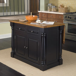 "Home Styles - Monarch Kitchen Island - Monarch Kitchen Island with Roll Out Leg and Wood Top Home Styles Monarch Rollout leg kitchen cart is constructed of solid hardwoods and engineered woods in a rich multi-step black finish with a distressed oak top for an aged look. Features include rollout legs to maximize space, doors that open to storage with an adjustable shelf, and two utility doors for added storage. Size: 36"" H x 46"" W x 25"" D (with leg extension size is 36"" H x 46"" W x 40.5"" D) Traditional Swivel Bar Stool Rich in old world style, the Traditions Swivel Bar Stool brings bold design to any kitchen or recreational room. From the slight arc and diamond pattern of the back to the tapered legs, this stool draws the eye from top to bottom. Construction is of hardwood solids and hardwood veneers in a Black finish with a black leather, 360 swivel. Seat height measures 24"" from the floor. Arm height measures 31.75"" from the floor."