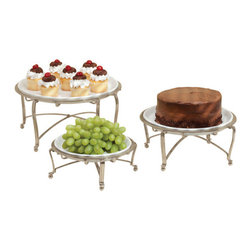 Satin Buffet Servers - Round (Set of 3) - Give your buffet table a restaurant quality display with these Satin Buffet Servers. Available in a set of three different sizes, these Satin Buffet Servers come with white ceramic plates to let you easily go from cooking to serving. These Satin Buffet Servers also have raised metal stands with a satin finish that will keep hot dishes off of counter tops and tables. Bring an interesting display to your next party with these Satin Buffet Servers.