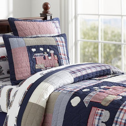 Toby Quilted Bedding - All aboard! This classically styled, hand-quilted design adds a playful mix of pattern and a timeless train theme to the bedroom.