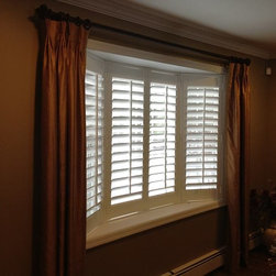 Shutter Jobs that we have completed for Customers - Hunter Douglas Newstyle Hybrid Shutters look beautiful in a bay window.  This customer was very happy with how pretty this turned out.
